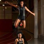 Rush Henrietta's Lanae-Tava Thomas leaps over teammate Sammy Watson..