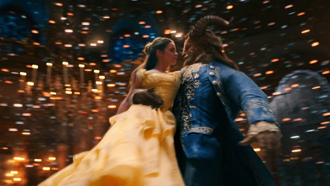 "Belle (Emma Watson) comes to realize that underneath the hideous exterior of the Beast (Dan Stevens) there is the kind heart of a Prince in ""Beauty and the Beast."""