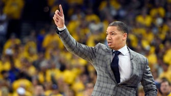 Tyronn Lue calls a play during the first quarter against the Golden State Warriors in game seven of the NBA Finals at Oracle Arena.