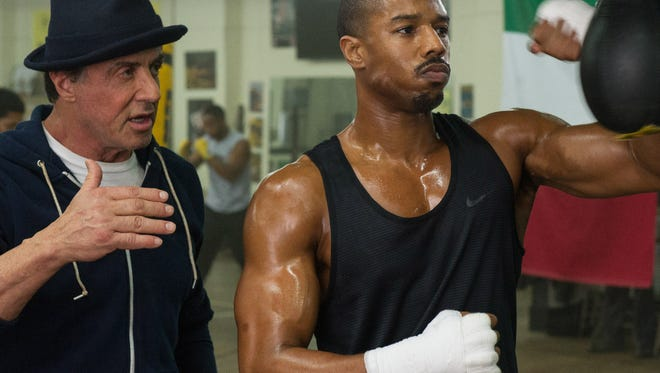 """This photo shows Michael B. Jordan, right, as Adonis Johnson and Sylvester Stallone as Rocky Balboa in Metro-Goldwyn-Mayer Pictures', Warner Bros. Pictures' and New Line Cinema's drama """"Creed,"""" a Warner Bros."""