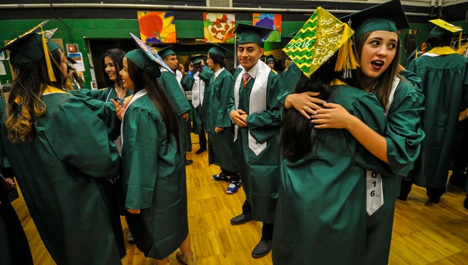 Tazmeen Khan and Brittany Santos embrace in a hug at John F. Kennedy Elementary School prior to South Plainfield High School graduation at Frank R. Jost Field on June 17, 2016.