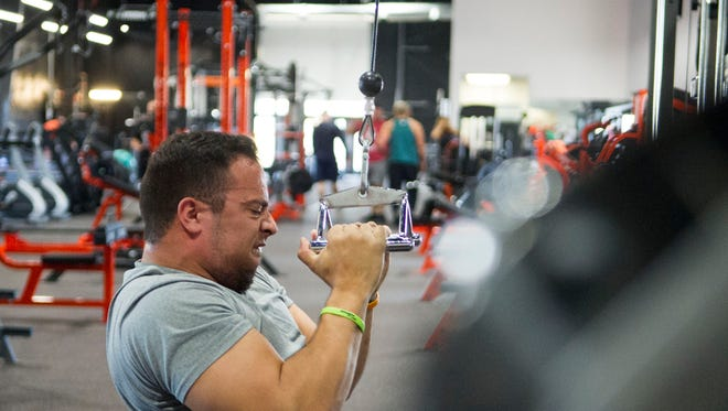 Alex Nicely works out in Arsenal Strength Training Facility in West Knoxville on Saturday, Oct. 15, 2016. Nicely, who has cerebral palsy, runs a nonprofit called Life With Purpose, which puts on powerlifting meets and helps pay for physical therapy for children with disabilities.