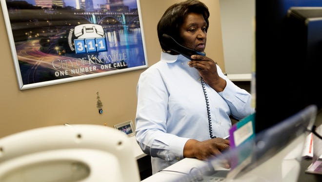 Shawanna Tipton, Customer Service Supervisor of the 311 Center, helps a customer during an open house tour of the city's revamped 311 Center at the City County Building on Wednesday, January 11, 2017. The remodeled space serves as an information hub for callers as well as visitors for information regarding city and social services. Callers can dial 311 to access the service.