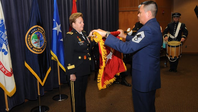 Maj. Gen. Heidi V. Brown, most recently U.S. Strategic Command's director of global operations, receives her personal colors during her retirement ceremony on Friday at Offutt Air Force Base in Nebraska.