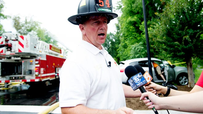 Knoxville Fire Department Spokesman Capt. D.J. Corcoran speaks to the media while responding to a June 2017 fire.