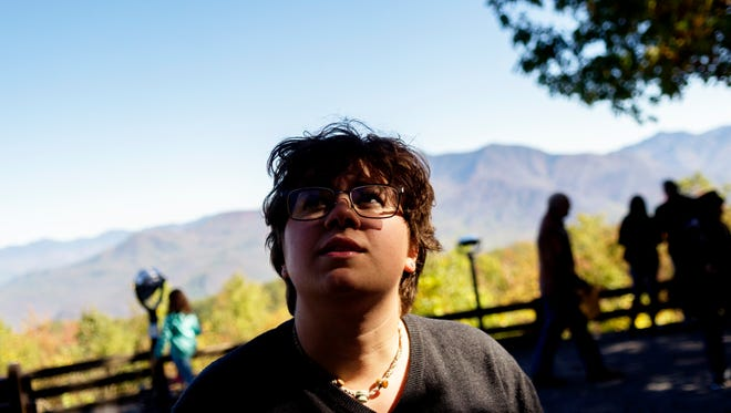 Lauren Van Lew, 20, of Sevierville, who is colorblind, describes what foliage looks like to her normally after viewing the leaves through special lenses. An event was held for colorblind people to view fall foliage through specially equipped viewfinders, enabling them to fully see the beauty of the Smoky Mountains for the first time, at Ober Gatlinburg in Gatlinburg, Tennessee, on Thursday, October 26, 2017.