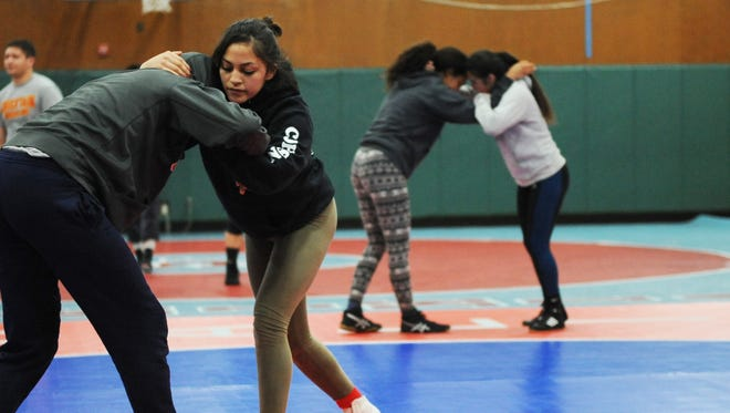 North Salinas wrestler Carolina Johnson practices Wednesday night. The 4-foot-11 senior will compete in the state championships February 23-24 in the 111-pound weight class.