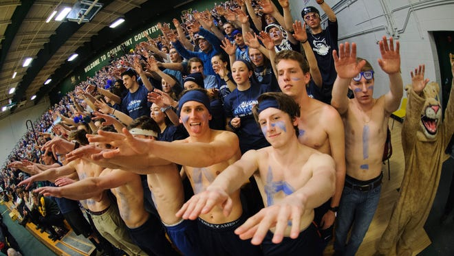 MMU fans cheer for the team during the Vermont state division I boys basketball semifinal game between the Mount Mansfield Cougars and the Rice Green Knights at Patrick Gym on Thursday night March 15, 2018 in Burlington.