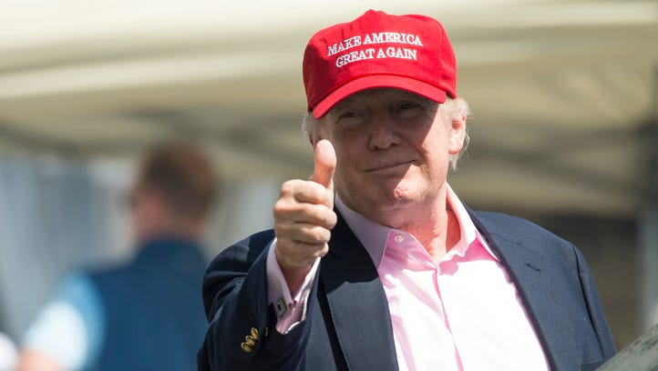 President Donald Trump gives a thumbs-up well wishers