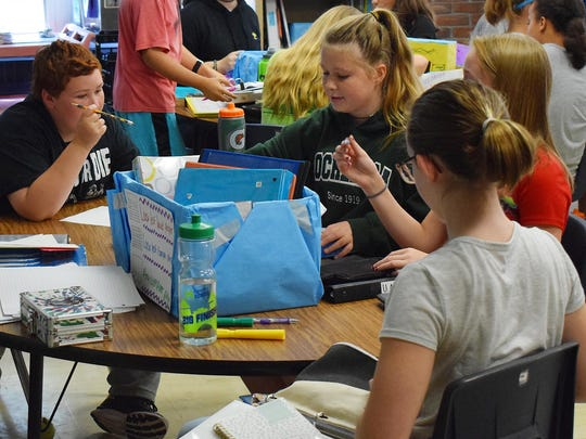 Students at Essex Middle School sort gently used school