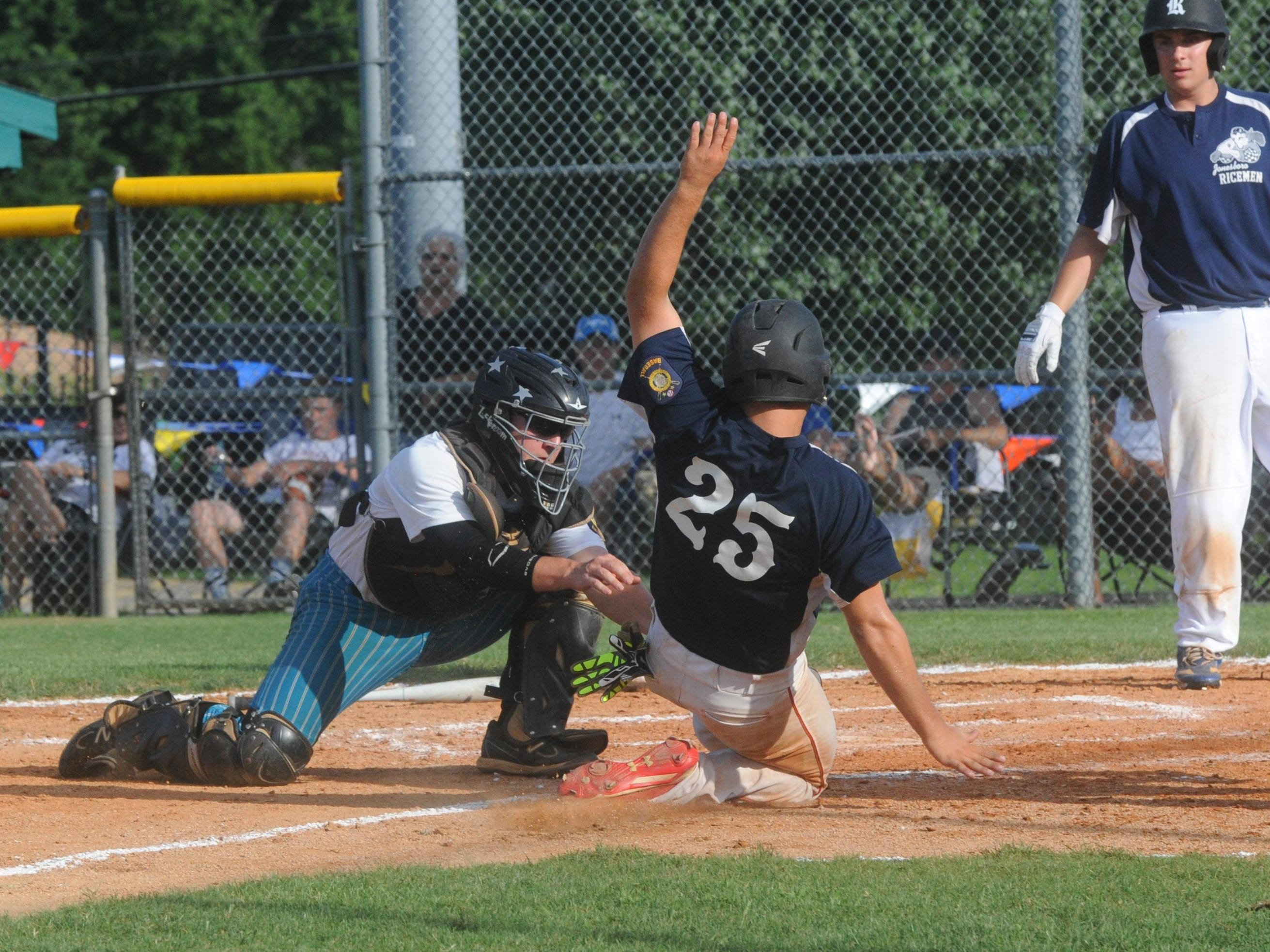 Lockeroom catcher Brody Ninemire, left, tags out Jonesboro's Trey Hall at home plate during Mountain Home's 8-0 loss to the Ricemen on Saturday at Cooper Park.