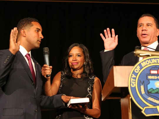 Mount Vernon Mayor Richard Thomas (left) is sworn in by former New York Gov. David Paterson at his 2016 inauguration. The mayor's wife ,Cherish, is at center.