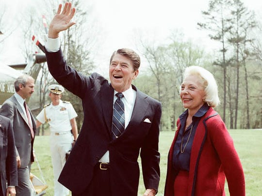 President Ronald Reagan, left, was a guest of the late Senator Howard Baker, Jr. at his home in Huntsville, Tenn. that will be sold at an absolute auction. He is with Joy Dirksen, the late first wife of Baker.