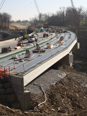 The green layer of reinforcing bars showed on the bridge deck for the new Ky. 16, also known as Pride Parkway, before the final concrete was poured. The bridge, seen here looking south, opens Wednesday, Dec. 31.