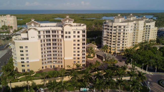 The recently completed AQUA Tower II features three levels of penthouses sited adjacent to the Pelican Isle Yacht Club at Wiggins Pass.