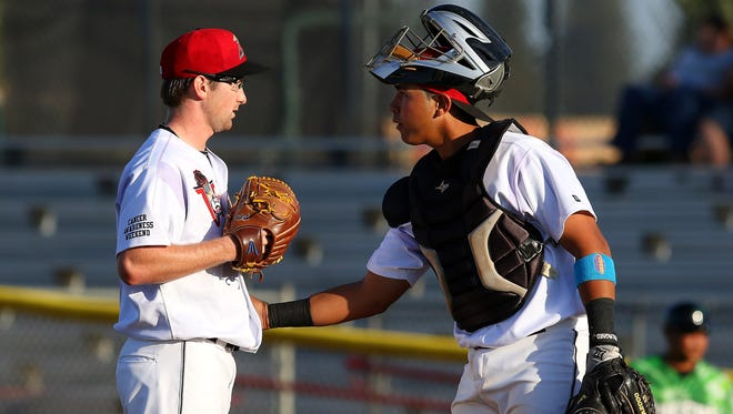 Volcanoes pitcher Grant Watson gets some encouragement from catcher Fernando Pujadas against Eugene at Volcanoes Stadium, Thursday, August 20, 2015, in Keizer, Ore.