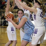 Lansing Catholic senior Maria Repichowski is surrounded by Fowlerville defenders during Wednesday's Class B district semifinal.
