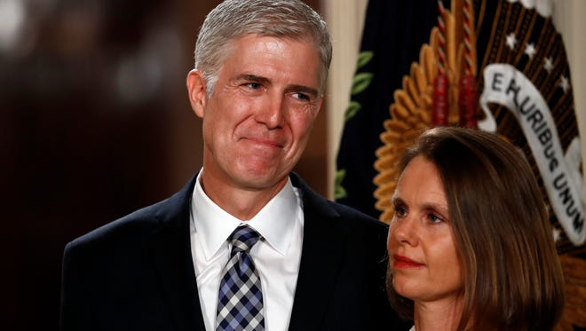 Judge Neil Gorsuch stands with his wife, Louise, as President Donald Trump speaks in the East Room of the White House in Washington, Tuesday, Jan. 31, 2017, to announce Gorsuch as his nominee for the Supreme Court.
