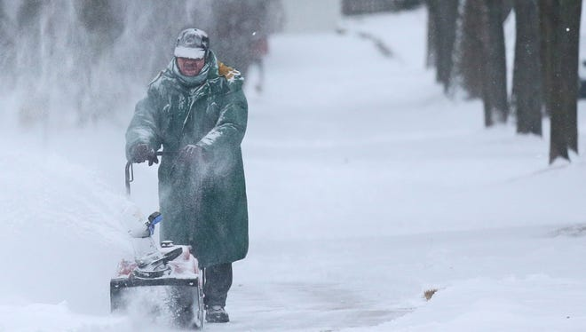 Vince Adesso blows snow in the 4100 block of N. Downer in Shorewood.