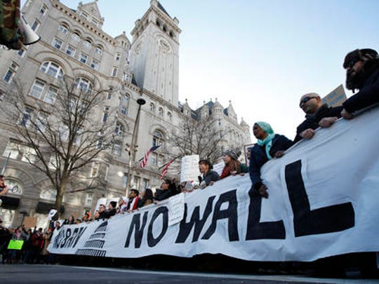 Protesters march along Pennsylvania Avenue past the