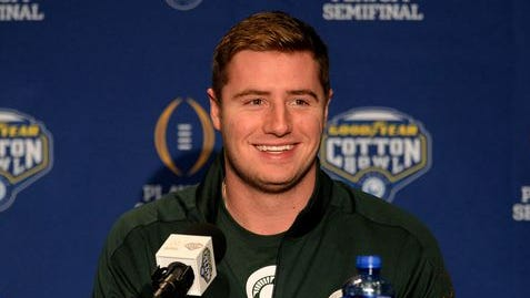 MSU quarterback Connor Cook smiles during a Cotton Bowl press conference Monday at the Omni Hotel in Dallas.