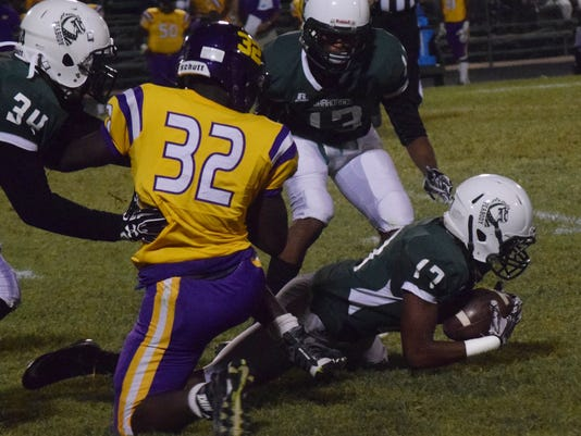 Peabody's Kenneth Williams (17, far right) recovers a fumble by Wossman's Devonte Brown (32, center) as teammates Troy Williams (34, far left) and Travion Brass (13, back right) look on.