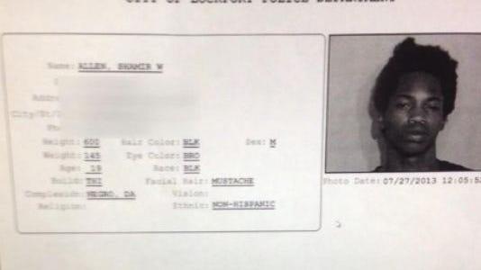 Police report where a suspect is described as a dark Negro.