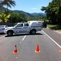 A police car blocks a street at an address in Manoora  where up to eight victims have reportedly been stabbed to death, near Cairns, Australia.