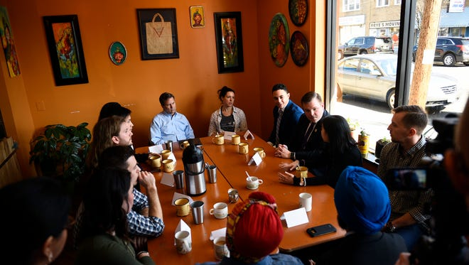Congressman Donald Norcross listens as young professionals and students participate in a discussion referred to as 'Coffee with a Congressman' inside The Square Meal Tuesday, Feb. 20, 2018 in Oaklyn, N.J.