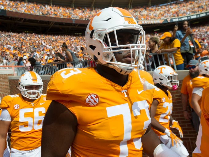 Tennessee offensive lineman Trey Smith (73) runs out