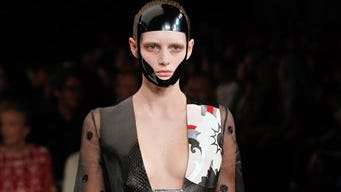 A model wears a creation as part of Alexander McQueen's Spring/Summer 2015 ready-to-wear fashion collection presented in Paris, France, Tuesday.