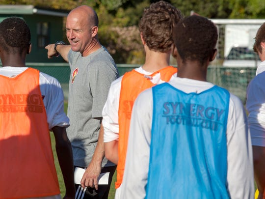 Synergy coach Hugh Brown talks to his players during a break from training last week at Centennial Field.