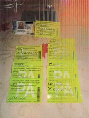 John P. Wolfe's used these hunting licenses as exhibits in his defense during a May 2016 trial.