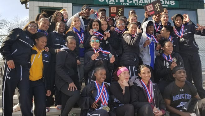 Passaic Tech boys and girls celebrating their team victories at the Passaic County Relays on Saturday, April 7, 2018.