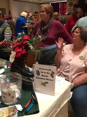 Members of the Artisans Guild sold upcycled holiday decorations, recycled gifts cards, and quilts at the 2016 Eco-Art Show, raising money for the Homeless Shelter.