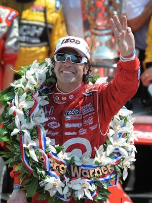 Dario Franchitti celebrates winning the 96th Indianapolis 500 Sunday, May 27, 2012, afternoon at the Indianapolis Motor Speedway.