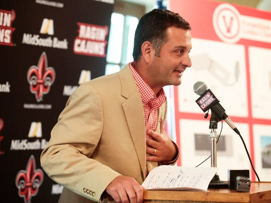 UL golf coach Theo Sliman is shown at a press conference in 2006. His team is ranked first nationally among NCAA Division I golf teams in community service.