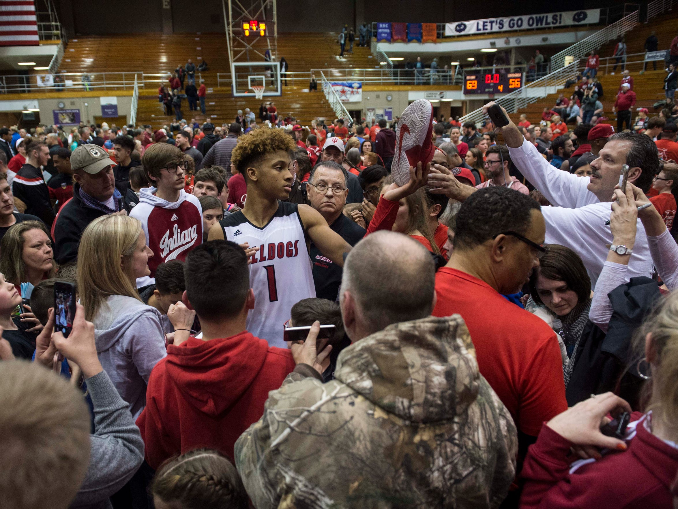New Albany's Romeo Langford (1) is surrounded by fans
