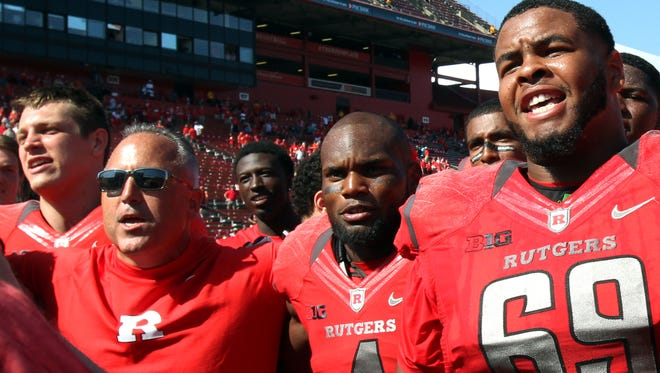 Rutgers coach Kyle Flood and wide receiver Leonte Carroo (4) celebrated side-by-side a season-opening win against Norfolk State.
