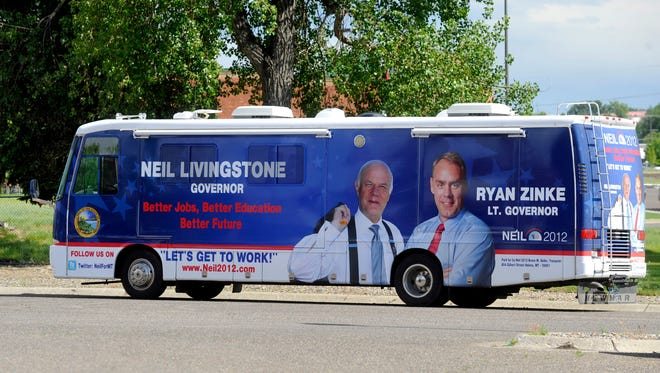 This July 14, 2011 photo shows the campaign bus of Neil Livingstone, candidate for Governor and Ryan Zinke, candidate for Lt. Governor in Great Falls, Mont.
