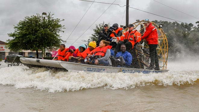 In late August, volunteers and first responders work together to rescue Texas residents from rising floodwaters in Houston.
