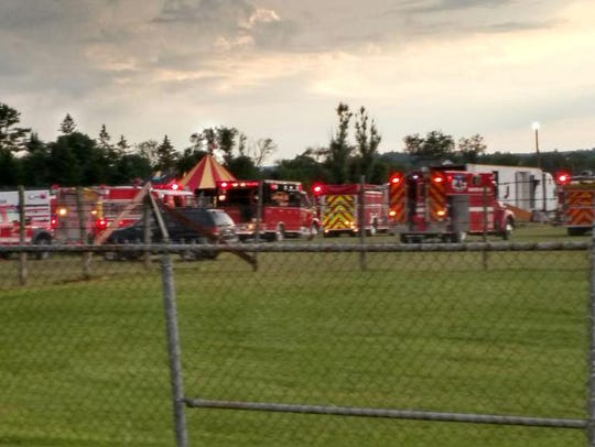 Officers surround the scene of a tent collapse in Lancaster,
