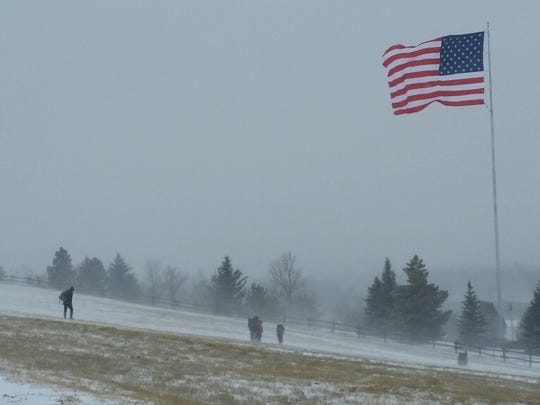 The Ice Bowl Disc Golf Tournament went on despite 40 mile per hour wind gusts and snow.