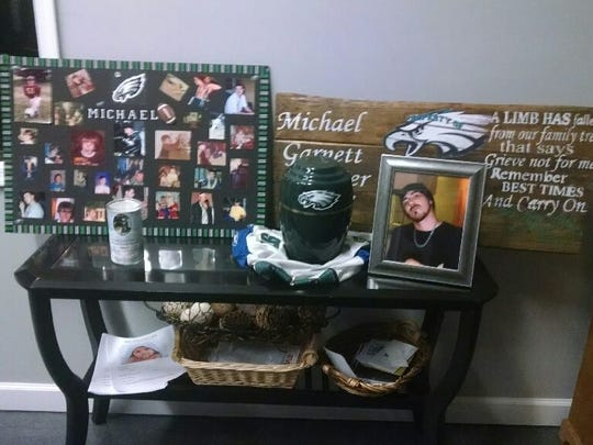 Various items are shown to remember Michael Sautter at his memorial service.