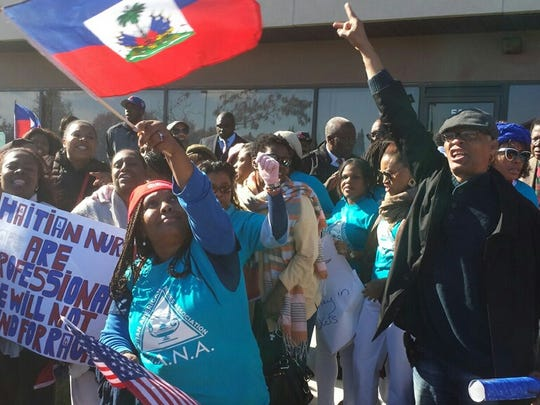 """Hundreds marched Monday through Spring Valley to protest a """"no haitians"""" need apply ad that was published in a local Pennysaver."""