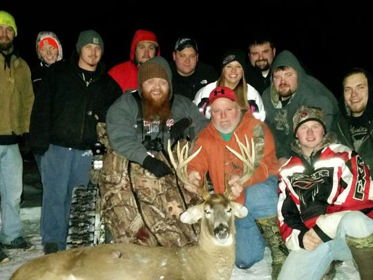Kyle Rosner and his dad Jeff pose with 10 of Kyle's