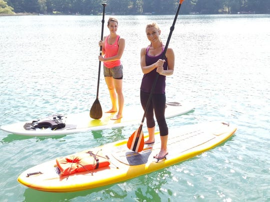 Discover Wisconsin host Mariah Haberman and friend take on standup paddle board yoga in Waupaca.