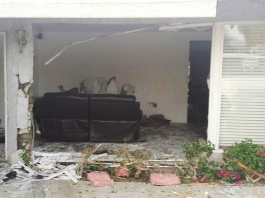 A home was damaged after a driver struck it several times with a pickup. Three people were seriously injured, officials said.