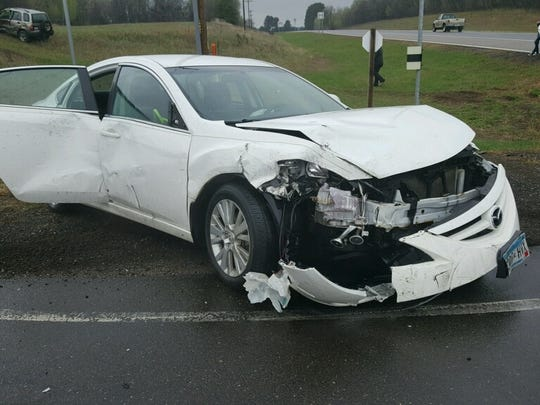 This is the car of columnist Tim Johnson's friend Kristine Sylvester after it was hit by another driver trying to take a photo while driving.