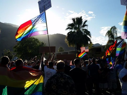 Valley residents attend a vigil for Orlando Shooting victims in downtown Palm Springs June 13, 2016.